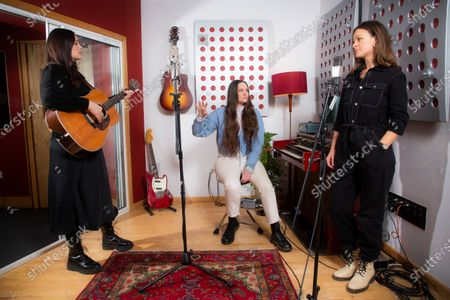 English indie folk trio, The Staves, from left sisters, Jessica, Camilla and Emily Staveley-Taylor rehearse a song in a north London recording studio, following the launch of their new album 'Good Woman
