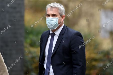 Stephen Barclay Chief Secretary to the Treasury arrives at Downing Street on Budget Day