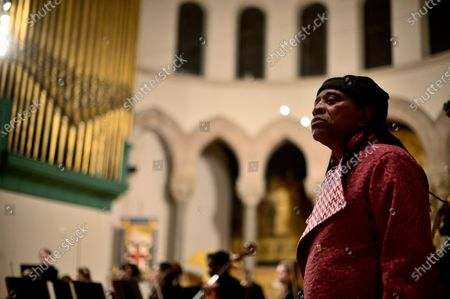 Composer Hannibal Lokumbe performs his 1973 composition Children of the Fire for the first time in the presence of Dr. Kim Phc, in Philadelphia, PA, on December 7, 2019. Dr. Phc is the subject of the iconic 1972 Napalm Girl Pulitzer Prize-wining photograph by now-retired Associated Press photographer Nick Ut.