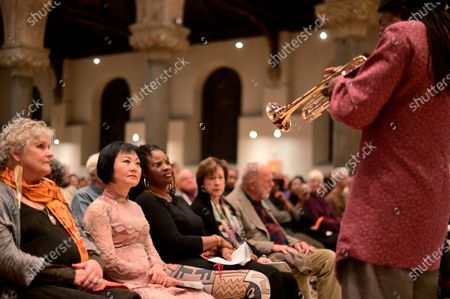 Dr. Kim Phc reacts when Hannibal Lokumbe performs his 1973 composition Children of the Fire for the first time in the presence of the Girl in the Picture, in Philadelphia, PA, on December 7, 2019. Dr. Phc is the subject of the iconic 1972 Napalm Girl Pulitzer Prize-wining photograph by now-retired Associated Press photographer Nick Ut.