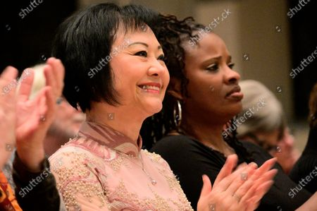 Stock Picture of Dr. Kim Phc reacts when Hannibal Lokumbe performs his 1973 composition Children of the Fire for the first time in the presence of the Girl in the Picture, in Philadelphia, PA, on December 7, 2019. Dr. Phc is the subject of the iconic 1972 Napalm Girl Pulitzer Prize-wining photograph by now-retired Associated Press photographer Nick Ut.