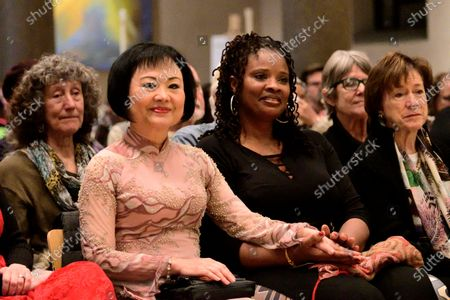 Dr. Kim Phc smiles as Hannibal Lokumbe performs his 1973 composition Children of the Fire for the first time in the presence of the Girl in the Picture, in Philadelphia, PA, on December 7, 2019. Dr. Phc is the subject of the iconic 1972 Napalm Girl Pulitzer Prize-wining photograph by now-retired Associated Press photographer Nick Ut.