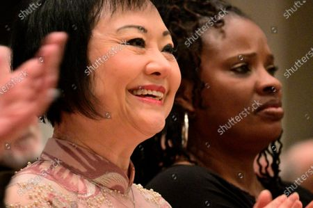 Stock Photo of Dr. Kim Phc reacts when Hannibal Lokumbe performs his 1973 composition Children of the Fire for the first time in the presence of the Girl in the Picture, in Philadelphia, PA, on December 7, 2019. Dr. Phc is the subject of the iconic 1972 Napalm Girl Pulitzer Prize-wining photograph by now-retired Associated Press photographer Nick Ut.