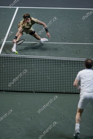 Russia's Andrey Rublev, left, plays a shot against Britain's Andy Murray, right, in their second round men's singles match of the ABN AMRO world tennis tournament at Ahoy Arena in Rotterdam, Netherlands