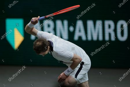 Britain's Andy Murray smashes his racket in his second round men's singles match of the ABN AMRO world tennis tournament against Russia's Andrey Rublev at Ahoy Arena in Rotterdam, Netherlands