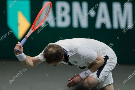 Britain's Andy Murray smashes his racket in frustration in his second round men's singles match of the ABN AMRO world tennis tournament against Russia's Andrey Rublev at Ahoy Arena in Rotterdam, Netherlands