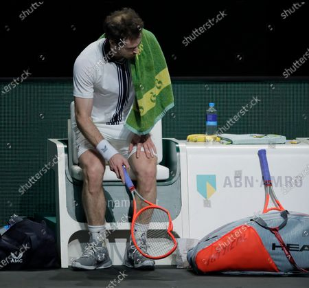 Britain's Andy Murray broke his racket in frustration in his second round men's singles match of the ABN AMRO world tennis tournament against Russia's Andrey Rublev at Ahoy Arena in Rotterdam, Netherlands