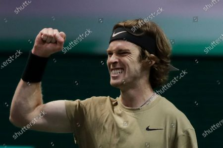 Russia's Andrey Rublev clenches his fist after scoring a point against Britain's Andy Murray in their second round men's singles match of the ABN AMRO world tennis tournament at Ahoy Arena in Rotterdam, Netherlands