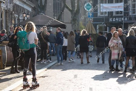 Open-air terraces of restaurants, cafes and bars, the HORECA industry opened in Breda city and across the country as part of an anti-lockdown protest action. People are seen outside enjoying their drinks or food served by the local restaurant despite the lockdown measure imposed by the Dutch government due to the Covid-19 Coronavirus pandemic to close and work partly. Owners of these shops are asking the government to open immediately the open-air areas. The initiave was supported by Forum for Democracy political party.  Breda, the Netherlands, on March 2, 2021.