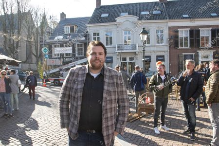 Initiator of the protest action and restaurant manager of Boerke Verschuren, Johan de Vos. Open-air terraces of restaurants, cafes and bars, the HORECA industry opened in Breda city and across the country as part of an anti-lockdown protest action. People are seen outside enjoying their drinks or food served by the local restaurant despite the lockdown measure imposed by the Dutch government due to the Covid-19 Coronavirus pandemic to close and work partly. Owners of these shops are asking the government to open immediately the open-air areas. The initiave was supported by Forum for Democracy political party.  Breda, the Netherlands, on March 2, 2021.