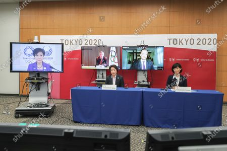 President of the Tokyo 2020 Olympics Organizing Committee Seiko Hashimoto, left, and Tokyo Olympic and Paralympic Games Minister Tamayo Marukawa, right, Tokyo Gov. Yuriko Koike, on left screen, International Olympic Committee (IOC) President Thomas Bach, on center screen, and International Paralympic Committee (IPC) President Andrew Parsons attend the opening remark session of a five-party meeting at the Tokyo 2020 headquarters in Tokyo . The Tokyo Organizing Committee of the Olympic and Paralympic Games (Tokyo 2020) held a five-party meeting on Wednesday with the Tokyo Metropolitan Government, the Government of Japan, IOC and IPC