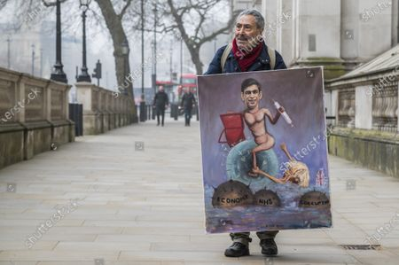 Kaya Mar with his latest satyrical art piece outside - Rishi Sunak, Chancellor of the Exchequer, leaves No 11 Downing Street and heads to Parliament to give his Budget. National Lockdown 3 due to Covid 19 is still in force but begins to ease next week.