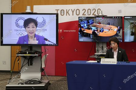 Tokyo Gov. Yuriko Koike, on left screen, speaks via teleconference as President of the Tokyo 2020 Olympics Organizing Committee Seiko Hashimoto listens during a five-party meeting at the Tokyo 2020 headquarters in Tokyo . The organizing committee held the five-party meeting with the Tokyo Metropolitan Government, the Government of Japan, the International Olympic Committee and the International Paralympic Committee
