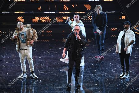 Gigi D'Alessio with five Italian rappers perform on stage at the Ariston theatre during the 71st Sanremo Italian Song Festival, in Sanremo, Italy, 03 March 2021. The festival runs from 02 to 06 March.
