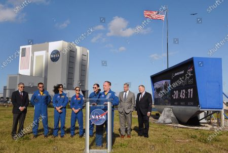 NASA astronaut Mike Fincke answers a question during a press briefing held by (from left) Kennedy Space Center Director Robert Cabana, NASA astronauts Josh Cassada, Suni Williams, and Nicole Mann, Boeing astronaut Chris Ferguson, NASA Administrator Jim Bridenstine, and Deputy NASA Administrator Jim Morhard near the countdown clock on December 19, 2019 in advance of tomorrow's scheduled orbital flight test of Boeing's CST-100 Starliner spacecraft, at the Kennedy Space Center in Florida.