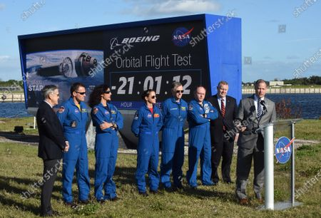 NASA Administrator Jim Bridenstine answers a question during a press briefing held by (from left) Kennedy Space Center Director Robert Cabana, NASA astronauts Josh Cassada, Suni Williams, and Nicole Mann, Boeing astronaut Chris Ferguson, NASA astronaut Mike Fincke, NASA Administrator Jim Bridenstine, and Deputy NASA Administrator Jim Morhard near the countdown clock on December 19, 2019 in advance of tomorrow's scheduled orbital flight test of Boeing's CST-100 Starliner spacecraft, at the Kennedy Space Center in Florida.