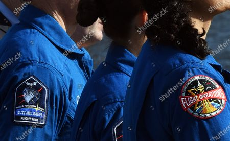 Shoulder patches are seen on the flight suits of Boeing astronaut Chris Ferguson (left) and NASA astronaut Suni Williams (right) during a press briefing on December 19, 2019 in advance of tomorrow's scheduled orbital flight test of Boeing's CST-100 Starliner spacecraft, at the Kennedy Space Center in Florida.