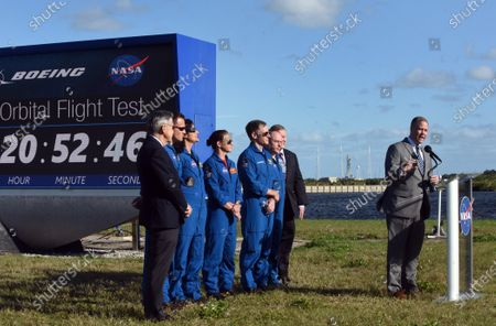 NASA Administrator Jim Bridenstine answers a question while (from left) Kennedy Space Center Director Bob Cabana, NASA astronauts Josh Cassada, Suni Williams, and Nicole Mann, Boeing astronaut Chris Ferguson, NASA astronaut Mike Fincke, and Deputy NASA Administrator Jim Morhard look on during a press briefing near the countdown clock on December 19, 2019 in advance of tomorrow's scheduled orbital flight test of Boeing's CST-100 Starliner spacecraft, at the Kennedy Space Center in Florida.