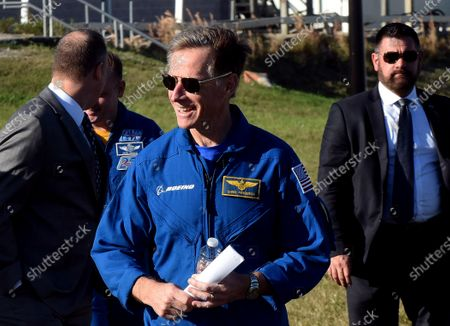 Boeing astronaut Chris Ferguson arrives with others for a press briefing on December 19, 2019 in advance of tomorrow's scheduled orbital flight test of Boeing's CST-100 Starliner spacecraft, at the Kennedy Space Center in Florida.