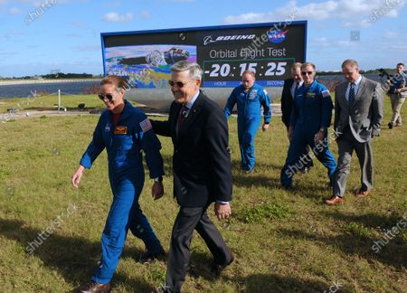 NASA astronaut Nicole Mann (from left), Kennedy Space Center Director Bob Cabana, NASA astronaut Mike Fincke, Deputy NASA Administrator Jim Morhard, Boeing astronaut Chris Ferguson, and NASA Administrator Jim Bridenstine depart following a press briefing near the countdown clock on December 19, 2019 in advance of tomorrow's scheduled orbital flight test of Boeing's CST-100 Starliner spacecraft, at the Kennedy Space Center in Florida.