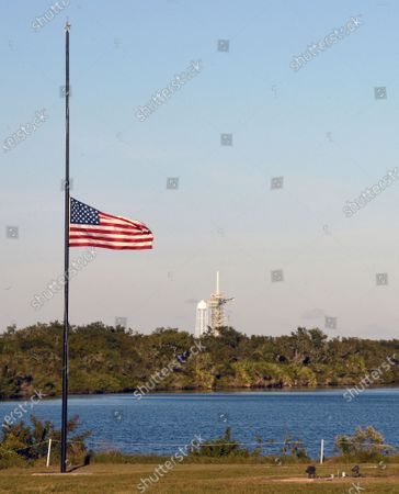 December 5, 2018 - Kennedy Space Center, Florida, United States - Hours after SpaceX successfully launched a Falcon 9 rocket with supplies for the International Space Station (ISS) from Cape Canaveral Air Force Station, a flag is seen at half-staff on December 5, 2018 at the nearby Kennedy Space Center in Florida in honor of former U.S. President George H.W. Bush who died on November 30, 2018.