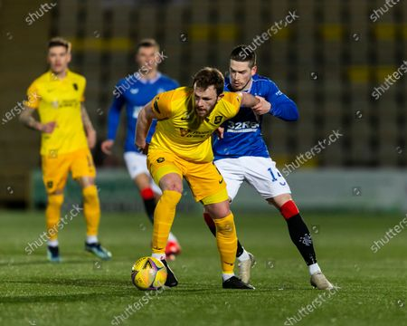 Rangers Forward Ryan Kent challenges for the ball