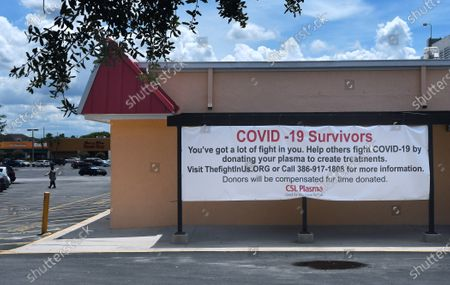 A sign soliciting COVID-19 survivors to donate plasma is seen at CSL Plasma on August 15, 2020 in Orange City, Florida. The antibodies contained in plasma donated by persons who have recovered from COVID-19 is being used by researchers to develop a treatment for those currently infected with the disease.