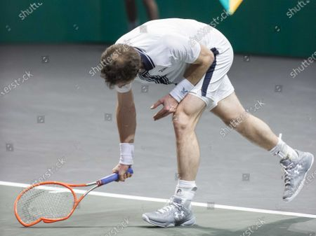 Stock Picture of Andy Murray of Britain smashes his racket during his match against Andrey Rublev of Russia on the third day of the ABN AMRO World Tennis Tournament in Rotterdam, The Netherlands, 03 March 2021. The ATP tournament in Ahoy takes place without an audience due to the corona pandemic.