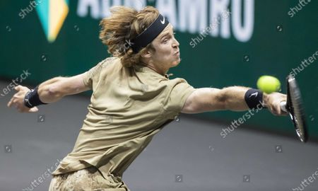 Stock Photo of Andrey Rublev of Russia in action against Andy Murray of Britain on the third day of the ABN AMRO World Tennis Tournament in Rotterdam, The Netherlands, 03 March 2021. The ATP tournament in Ahoy takes place without an audience due to the corona pandemic.