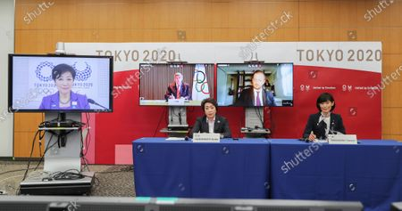 This photo shows the opening remark session of a five-party meeting held by the Tokyo Organizing Committee of the Olympic and Paralympic Games (Tokyo 2020) at the Tokyo 2020 headquarters in Tokyo on . From left are, Tokyo Gov. Yuriko Koike, Thomas Bach, back center, president of the International Olympic Committee (IOC), Andrew Parsons, president of the International Paralympic Committee, Seiko Hashimoto, front row, left, president of the Tokyo 2020 Organizing Committee, and Tamayo Marukawa, minister for the Tokyo Olympic and Paralympic Games