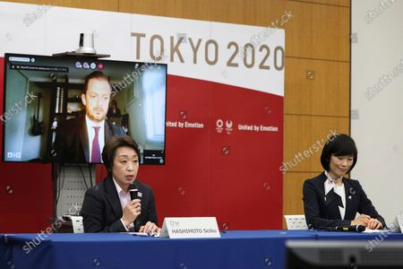 Seiko Hashimoto, front left, president of the Tokyo Organizing Committee of the Olympic and Paralympic Games (Tokyo 2020), speaks as Andrew Parsons, back left, president of the International Paralympic Committee, and Tamayo Marukawa, minister for the Tokyo Olympic and Paralympic Games, listen at a five-party meeting at the Tokyo 2020 headquarters in Tokyo on . Tokyo Gov. Yuriko Koike and Thomas Bach, president of the International Olympic Committee were also at the meeting