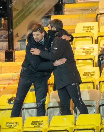 Rangers Manager Steven Gerrard celebrates after the final whistle in the stand with analyst Scott Mason after Gerrard was sent off by referee John Beaton at half-time