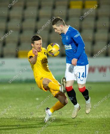 Jason Holt of Livingston challenges Ryan Kent of Rangers