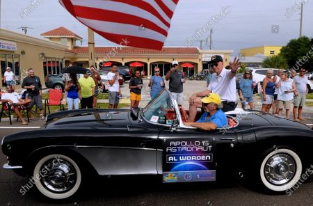Apollo 15 astronaut Al Worden waves from a vintage Corvette in a parade with twelve other astronauts to celebrate the 50th anniversary of the Apollo 11 moon landing on July 13, 2019 in Cocoa Beach, Florida.