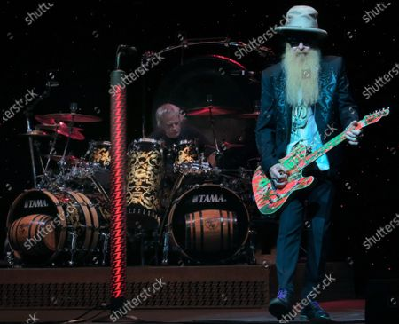 Stock Image of Frank Beard (left) and Billy Gibbons of the band ZZ Top perform in concert at the King Center for the Performing Arts on October 22, 2019 in Melbourne, Florida.