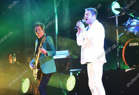 John Taylor (left) and Simon Le Bon perform with Duran Duran in the rocket garden at the Kennedy Space Center Visitor Complex in honor of the 50th anniversary of the Apollo 11 moon launch on July 16, 2019 in Cape Canaveral, Florida.