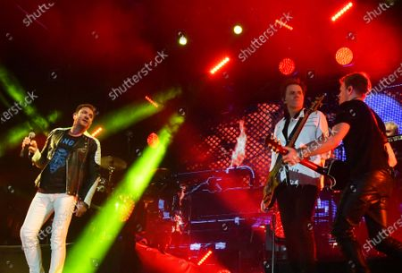 Simon Le Bon, (from left) John Taylor, and Dominic Brown perform with Duran Duran in a concert at the Kennedy Space Center Visitor Complex Rocket Garden in honor of the 50th anniversary of the Apollo 11 moon launch on July 16, 2019 in Cape Canaveral, Florida.