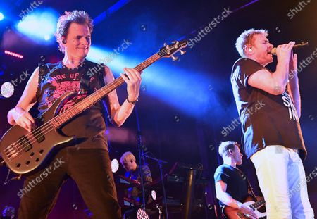 John Taylor (left) and Simon Le Bon perform with Duran Duran in a concert at the Kennedy Space Center Visitor Complex Rocket Garden in honor of the 50th anniversary of the Apollo 11 moon launch on July 16, 2019 in Cape Canaveral, Florida.