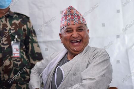Deputy Prime Minister Ishwar Pokhrel smiles before getting his first dose of covid-19 vaccine developed by Oxford- AstraZeneca Plc in Civil Hospital, Kathmandu, Nepal on Wednesday, March 3, 2021. Federal lawmakers, parliament secretariat staffers, ministers and senior leaders took their first dose of the vaccine against Covid-19 to attend House session called on March 7, 2021.