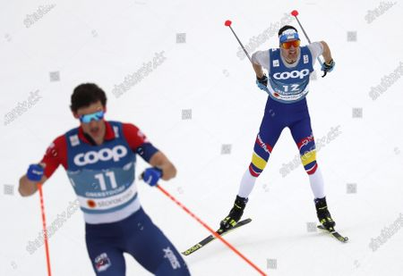 Stock Image of Great Britain's Andrew Young, left, and Andorra's Ireneu Esteve Altimiras, right, compete during the WSC Men's Interval 15km Free Cross Country event at the FIS Nordic World Ski Championships in Oberstdorf, Germany