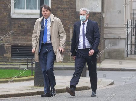 Economic Secretary to the Treasury, John Glen(Left), arrives in Downing Street with Stephen Barclay, Chief Secretary to the Treasury, on Budget day. The Chancellor, Rishi Sunak will deliver his budget.