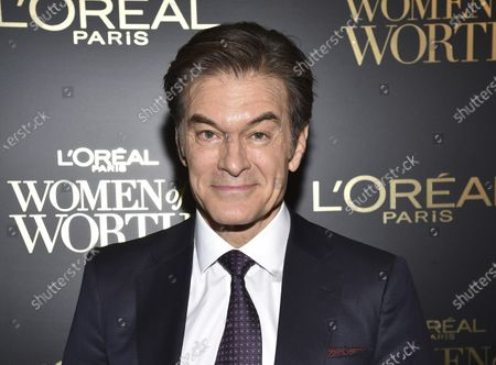 """Dr. Mehmet Oz at the 14th annual L'Oreal Paris Women of Worth Gala in New York. Oz, the cardiac surgeon and longtime host of TV's """"Dr. Oz Show,"""" rendered aid a 60-year-old traveler at Newark Liberty International Airport on . Oz, along with Port Authority Officer Jeffrey Croissant, performed CPR on the man until three more officers arrived to provide oxygen and activate a defibrillator"""