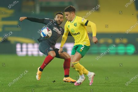 Saman Ghoddos of Brentford (20) and Max Aarons of Norwich City (2)