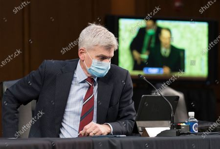 Senate Finance Committee member Sen. Bill Cassidy, R-La., listens as the panel considers a vote on Xavier Becerra, President Joe Biden's Health and Human Services Dept. nominee, at the Capitol in Washington
