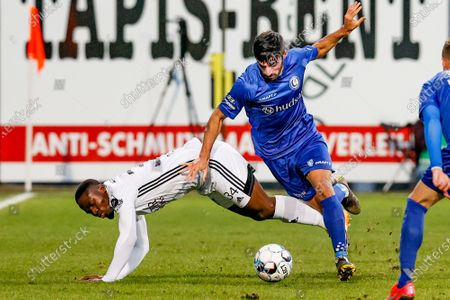 Eupen's Konan N'Dri and Gent's Milad Mohammadi fight for the ball during a soccer game between KAS Eupen and KAA Gent, Wednesday 03 March 2021 in Eupen, in the 1/4 finals of the 'Croky Cup' Belgian cup.