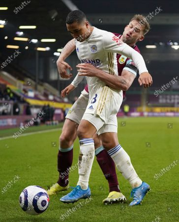 Leicester's Youri Tielemans, left, and Burnley's Charlie Taylor challenge for the ball during the English Premier League soccer match between Burnley and Leicester City at Turf Moor stadium in Burnley, England