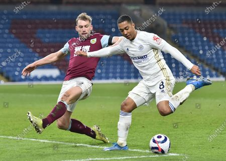 Burnley's Charlie Taylor, left, in action with Leicester's Youri Tielemans during the English Premier League soccer match between Burnley and Leicester City at Turf Moor stadium in Burnley, England