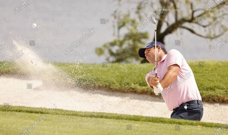 Stock Photo of Patrick Reed of the US hits out of a bunker on the seventh hole during the final practice round for the Arnold Palmer Invitational presented by Mastercard golf tournament at the Bay Hill Club & Lodge in Orlando, Florida, USA, 03 March 2021.