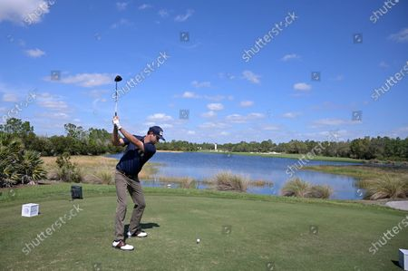 Harris English tees off on the 13th hole during the final round of the Workday Championship golf tournament, in Bradenton, Fla