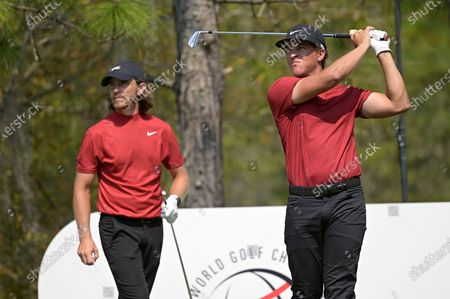 Tommy Fleetwood, left, of England, and Cameron Champ watch his tee shot on the 11th hole during the final round of the Workday Championship golf tournament, in Bradenton, Fla. Both are wearing clothing honoring Tiger Woods